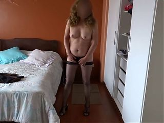 My horny wife touches herself and masturbates standing up